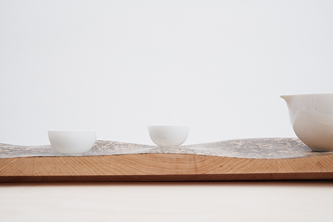 The Chun Collection tea set rests on the gentle undulations of the Inked Tray